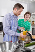Father cooking with his son in the kitchen - family life — Stock Photo