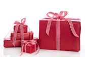Christmas: stack of red gift boxes with bow and ribbon, isolated — 图库照片