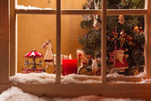 Atmospheric Christmas window sill decoration with snow, wood and candles — Stock Photo