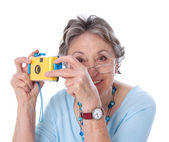 Mature lady with a camera — Stock Photo