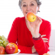Senior woman with fruits — Stock Photo #34182601