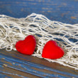 Hearts caught in net — Stock Photo