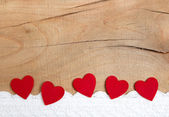 Hearts with wooden background — Stockfoto