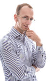Businessman with glasses looking at camera considering isolated — Stockfoto