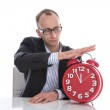 Businessman stopping time on red clock isolated — Stock Photo #34270495