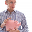 Man holding pink piggy bank saving money isolated  — Foto Stock