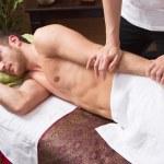 Man enjoying massage in salon — Stock Photo #34392101