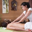 Stock Photo: Thai woman making massage to a man