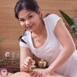 Stock Photo: Asian woman making massage to a man