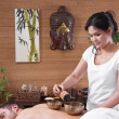 Stock Photo: Asiwommaking massage to man