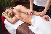 Man enjoying massage in salon — Stock Photo