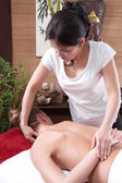 Asian woman making massage to a patient — Stock Photo