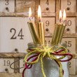 Shabby calendar with burning candles — Stock Photo #34438709