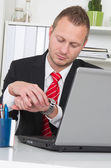 Businessman looking at watch — Stock Photo