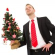 Business man holding christmas tree — Stock Photo