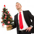 Stock Photo: Business man holding christmas tree