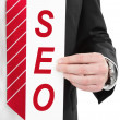 SEO sign in hand — Stock Photo