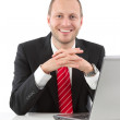 Successful businessman with laptop — Stock Photo #34577901