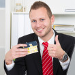 Businessman with house thumbs up — Stock Photo #34577969