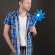 Dreamy man with pinwheel — Stock Photo #34578443