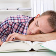 Student sleeping at desk — Stock Photo