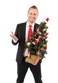 Business man with christmas tree — Stock Photo