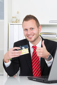 Businessman with house thumbs up — Foto Stock