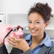Business womwith piggy bank — Stock Photo #34581011