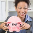 Business womwith piggy bank — Stock Photo #34581059