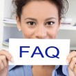 Woman with FAQ sign — ストック写真
