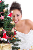 Lady behind christmas tree — Stock Photo
