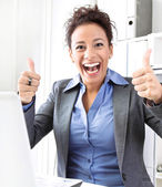 Laughing woman thumbs up — Stock Photo
