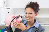 Business woman with piggy bank — Stock Photo