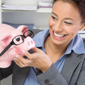 Smiling woman with savings — Stock Photo