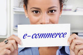 Woman with sign e-commerce — Stock Photo