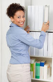 Business woman in office — Stockfoto