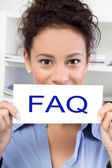 Woman with FAQ sign — Stock Photo