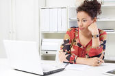 Woman bothered at work — Stock Photo