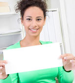Business woman showing sign board — Stock Photo