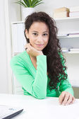Young lady in office — Stock Photo