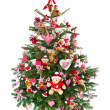 Colorfully decorated isolated Christmas tree with red decoration — ストック写真