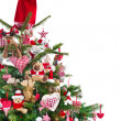 Colorfully decorated isolated Christmas tree with red decoration — Stok fotoğraf