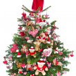 Colorfully decorated isolated Christmas tree with red decoration — Zdjęcie stockowe