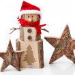 Wooden Christmas decoration: stars and santa hat on white background — Stock Photo