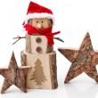 dřevěná Vánoční dekorace: hvězdy a santa hat na bílém pozadí — Stock fotografie #34627027