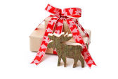 Christmas present in red with a wooden handmade elk or reindeer — Photo