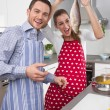 Young married couple in the kitchen - have fun and cooking fresh — Stock Photo