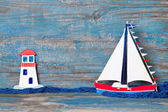 Sailboat and lighthouse decoration — Stock Photo