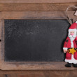 Chalk board for Merry Christmas message , santa on wooden background for a greeting card — Φωτογραφία Αρχείου