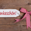 Thank you greeting card with a red white rustic checkered ribbon in country or shabby chic style on a white wooden sign — Stok fotoğraf
